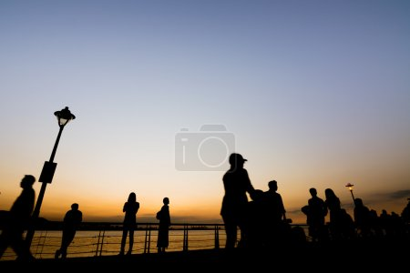 silhouette of people walk at Tamsui old street