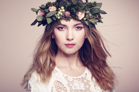 Beautiful blonde woman with flower wreath