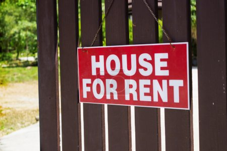 Photo for Announcement for rent house hanging on the fence - Royalty Free Image