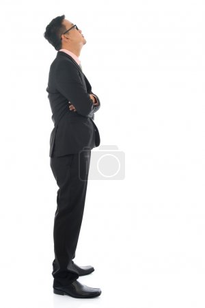 Photo for Full length confident southeast Asian business man crossed arms looking away standing isolated on white background. - Royalty Free Image