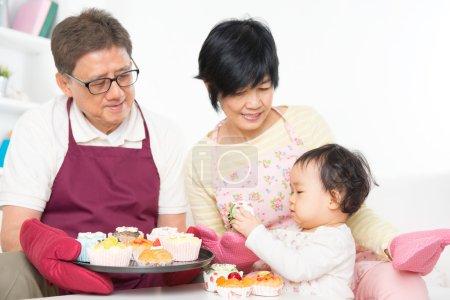 Asian family baking cake
