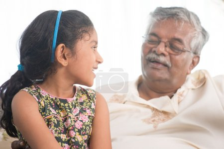 Grandfather and granddaughter communicate