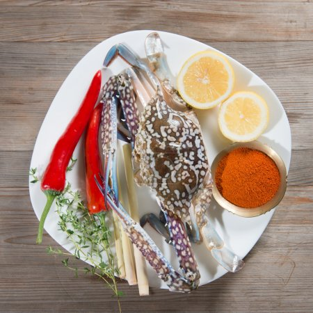 Raw blue crab and ingredients ready to cook