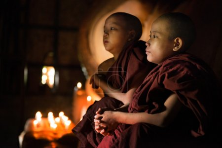 Buddhist novices praying inside temple