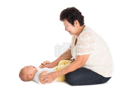 Grandmother comforting crying grandson.