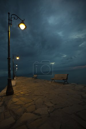 Night pier by the sea