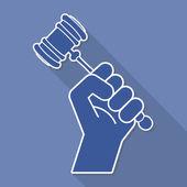 Judge gavel in hand symbol