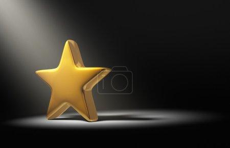 Spotlight On Gold Star On Dark Background