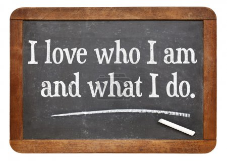 Photo for I love who I am and what I do - positive affirmation words on a vintage slate blackboard - Royalty Free Image