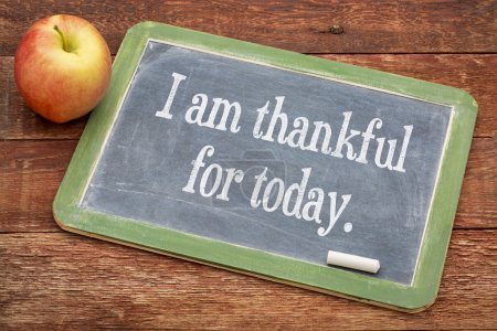Photo for I am thankful for today - positive words on a slate blackboard against red barn wood - Royalty Free Image