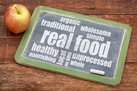 Photo for Real food word cloud on a blackboard with an apple - healthy lifestyle concept - Royalty Free Image