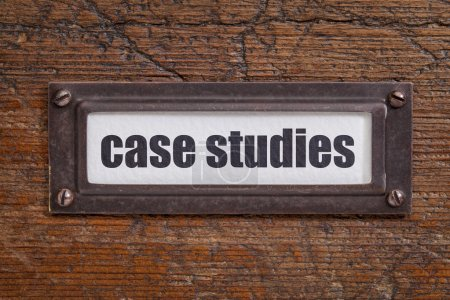 Photo for Case studies  - file cabinet label, bronze holder against grunge and scratched wood - Royalty Free Image