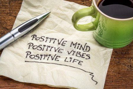 Photo for Positive mind,  positive vibes, positive life - motivational handwriting on a napkin with a cup of coffee - Royalty Free Image