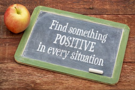 Photo for Find something positive in every situation  - motivational  words on a slate blackboard against red barn wood - Royalty Free Image