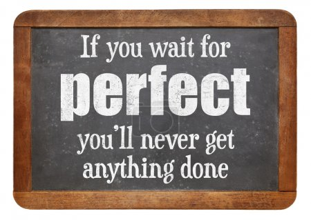 Photo pour If you wait for perfect you will never get anything done - words of wisdom on a vintage slate blackboard - image libre de droit