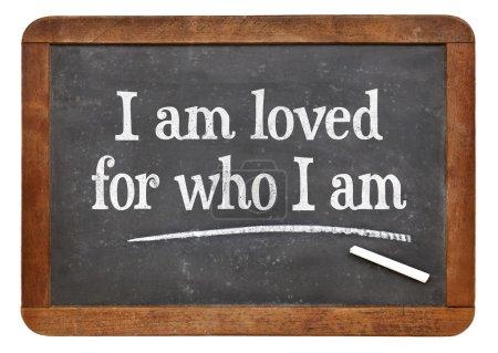 Photo for I am loved for who I am - positive affirmation words on a vintage slate blackboard - Royalty Free Image