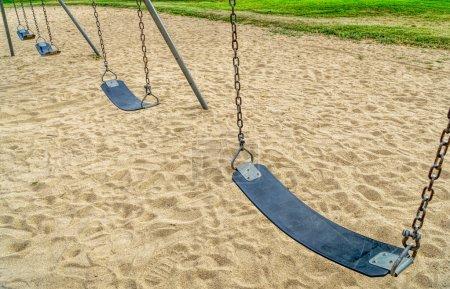 Empty swings in playground