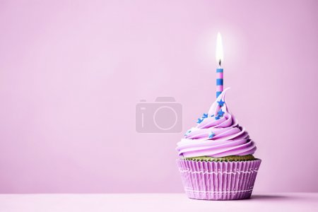 Photo for Purple birthday cupcake with copy space to side - Royalty Free Image