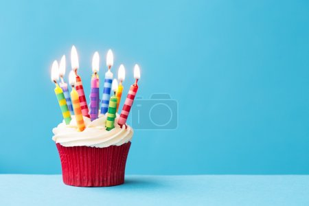 Photo for Birthday cupcake against a blue background - Royalty Free Image