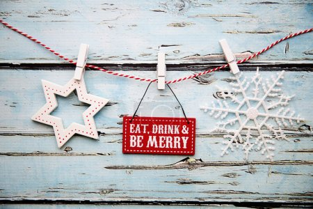 """Photo for """"Eat, drink and be merry"""" sign against a distressed wooden background - Royalty Free Image"""