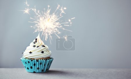 Photo for Cupcake decorated with a sparkler - Royalty Free Image