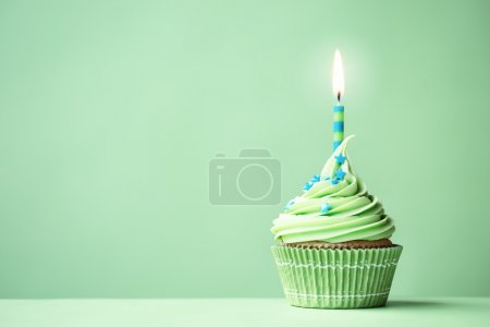 Photo for Green birthday cupcake with copy space to side - Royalty Free Image