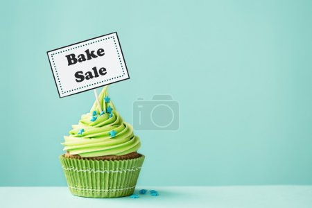 Cupcake with Bake Sale sign...
