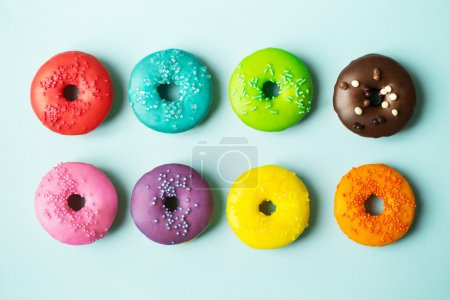 Photo for Colorful donuts on a blue background - Royalty Free Image