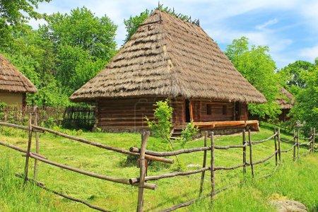 Old wooden house in museum of Folk Architecture in Uzhhorod, Ukraine