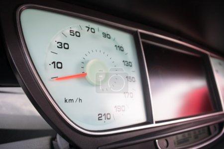 Car dashboard, close up speedometer