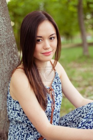 Photo for Asian woman resting in summer park outdoor - Royalty Free Image