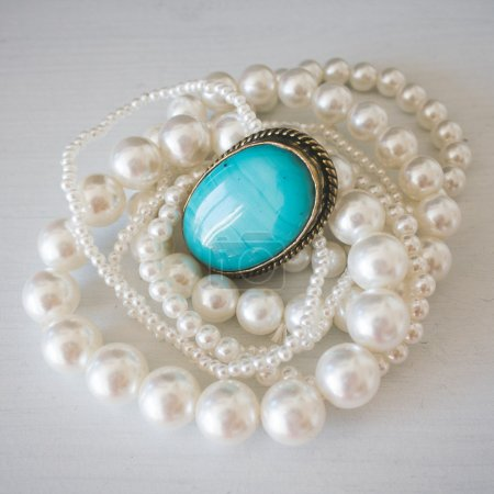 Jewel with turquoise stone and pearl necklace