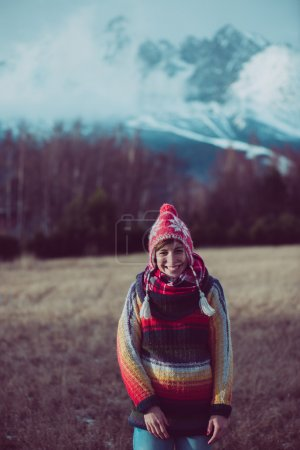 Photo for Young woman posing outdoor in front of high mountain range, filtered image - Royalty Free Image