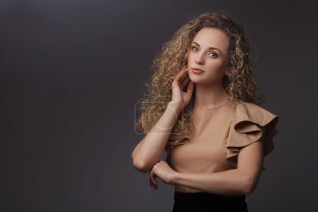 Portrait of perfect woman with curly hair
