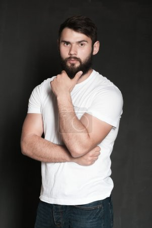 Photo for Portrait of handsome man with beard. Confident muscular man in white t-shirt on black background - Royalty Free Image