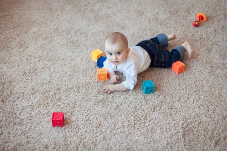 Baby playing with cubes