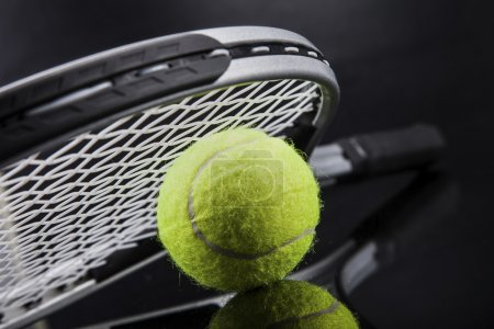 A set of tennis. Racket and ball.