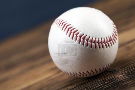Baseball ball on wooden table