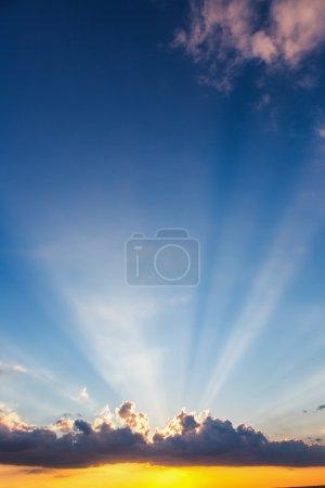 Sunset dramatic sky clouds with sunbeam