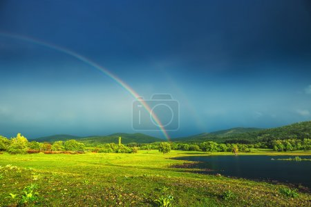 Photo for Rainbow over a lak - Royalty Free Image