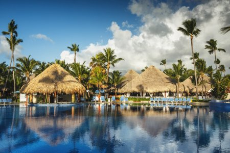 Sunrise over tropical swimming pool in luxury resort, Punta Cana