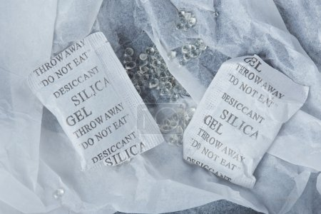 Silica gel balls lay in package white paper...