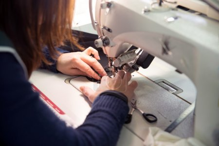 Photo for Seamstress sews garments luxury made in italy - Royalty Free Image