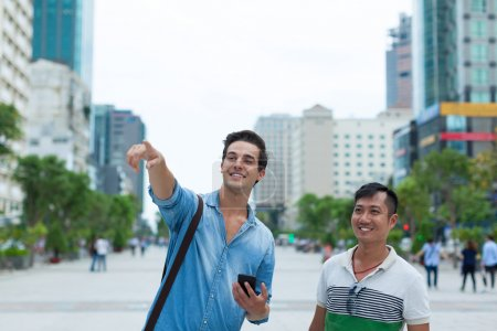 Photo for Two tourists  men walking city street - Royalty Free Image