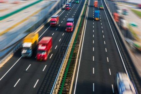 motion trucks on the freeway