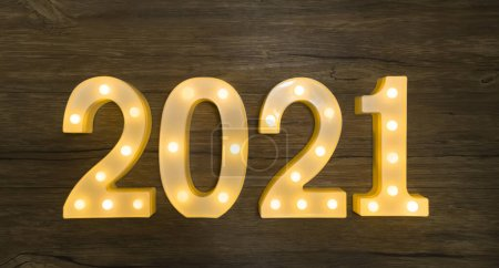 Photo for New Year bright light bulb numbers 2021 - Royalty Free Image