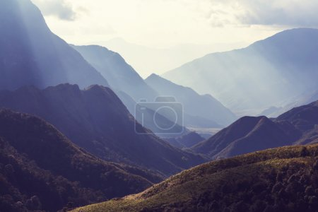 View of mountains with sun rays