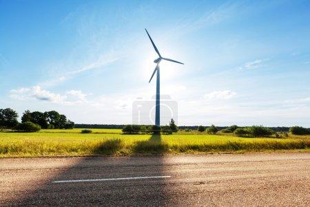 Windmill in the field near the road