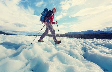 Hiker on glacier in Alaska