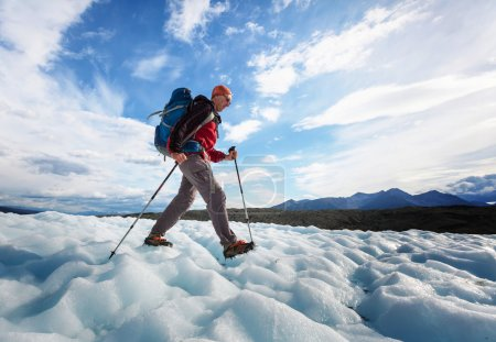 Hiker on glacier in Alaska